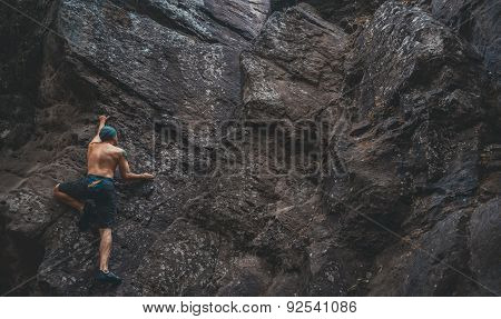 Man Climbing On Stone Rock
