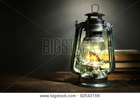 Kerosene lamp and letters on dark grey background
