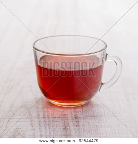 Cup of tea on wooden background.
