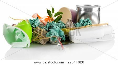 Pile of rubbish with plant isolated on white