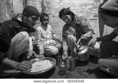 KATHMANDU, NEPAL - CIRCA DEC, 2013: Unknown children during dinner at Jagadguru School. School established in 2013, to let new generation learn Sanskrit and preserve Hindu culture.