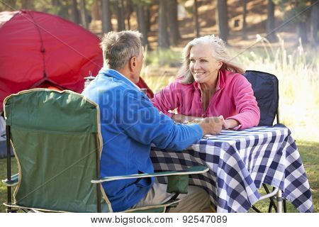 Senior Couple Enjoying Meal On Camping Holiday