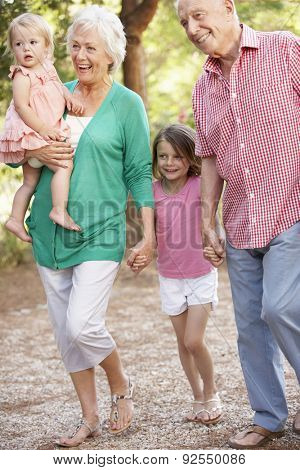 Grandparents On Country Walk With Grandchildren