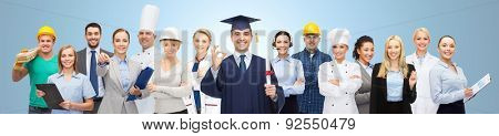 people, profession, education, gesture and success concept - happy bachelor with diploma showing ok sign over different workers and blue background