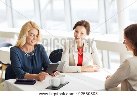 people, expenses, payment and lifestyle concept - happy women looking at restaurant bill