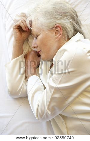 Senior Woman Sleeping In Bed