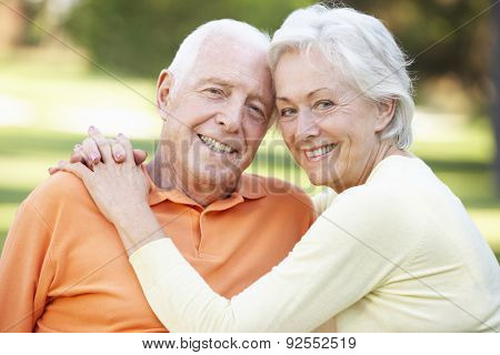 Head And Shoulders Portrait Of Romantic Senior Couple In Park