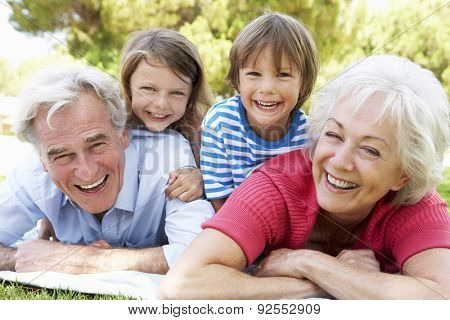 Grandparents And Grandchildren In Park Together