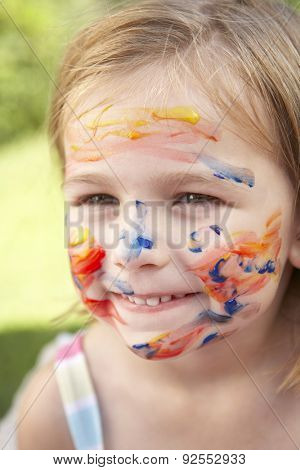 Head And Shoulders Portrait Of Girl With Painted Face