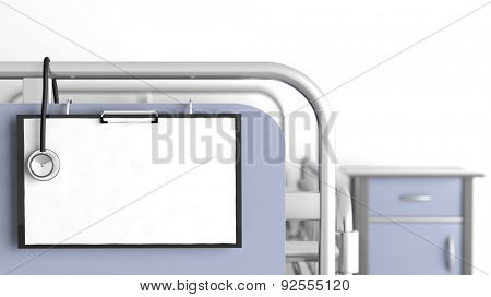 Hospital bed with focus on blank patient sheet with stethoscope