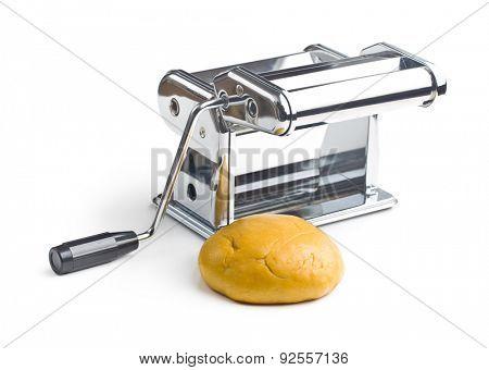 dough and pasta machine on white background