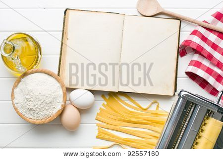 the cookbook and pasta ingredients