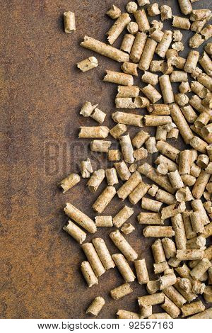 wooden pellets on old rusty background