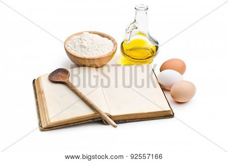 the cookbook and ingredients for preparing pasta