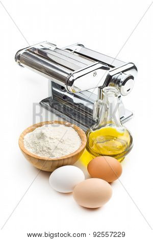 the ingredients for preparing pasta and pasta machine