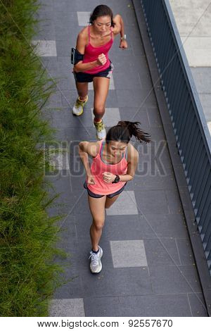 overhead view of active sporty women training outdoors for marathon run in morning