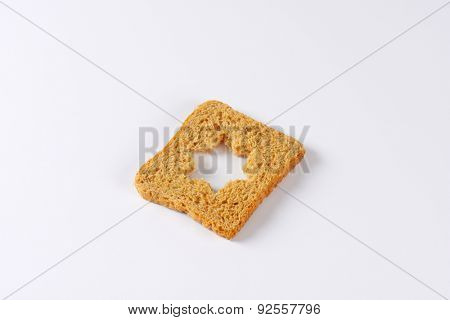 slice of whole grain toast bread with curved star in the middle