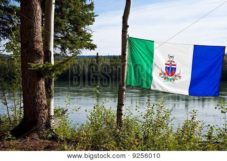 Yukon Flag In Front Of Yukon River