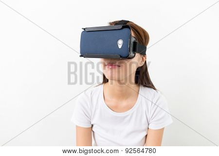 Young woman watching though the VR device