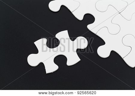 Plain puzzle over black background