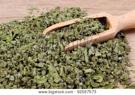 Dried Marjoram With Spoon On Wooden Background