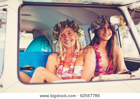 Beach Lifestyle. Beautiful Young Surfer Girls Having Fun Hanging Out in Vintage Surf Van. Best Friends.