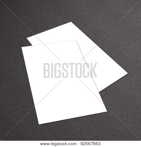 Blank white business card collection on a textured background
