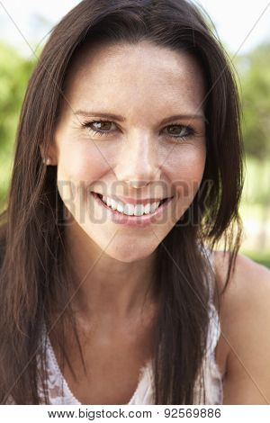 Head And Shoulders Portrait Of Smiling Woman