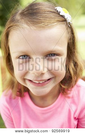Head And Shoulders Portrait Of Smiling Girl