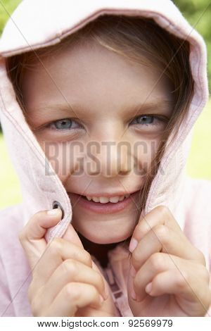 Portrait Of Girl Hiding Face In Pink Hooded Top