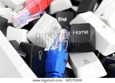 Black And White Pc Keyboard Keys In A Pile With Network Cables