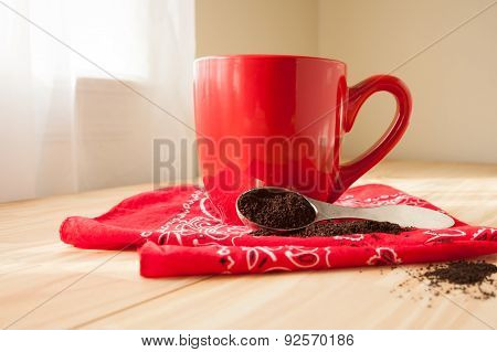 Red Coffee Mug With Napkin And Grounds