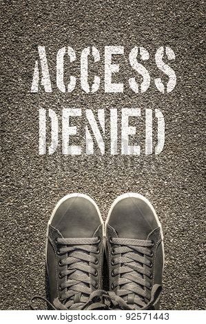 Access Denied Stencil Print On The Asphalt Road