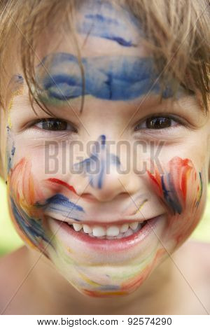 Head And Shoulders Portrait Of Boy With Painted Face