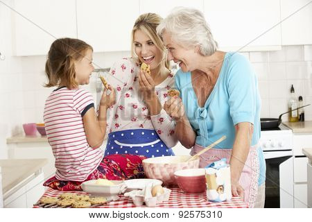 Mother,Daughter And Grandmother Baking In Kitchen