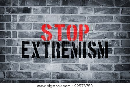 Stop Extremism Stencil Print On The Grunge White Brick Wall