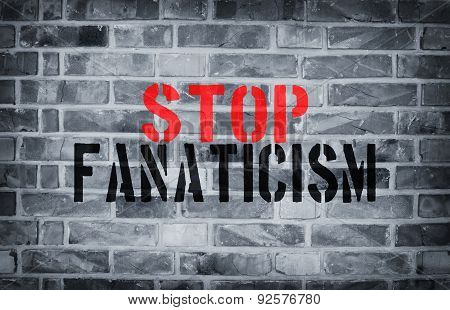 Stop Fanaticism Stencil Print On The Grunge White Brick Wall