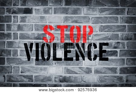 Stop Violence Stencil Print On The Grunge White Brick Wall