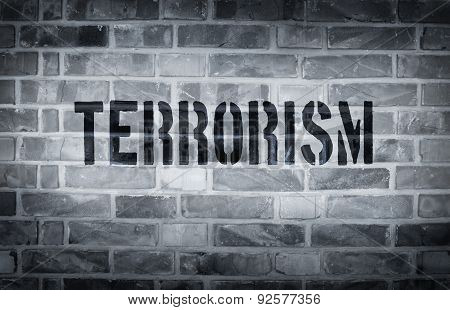 Terrorism Stencil Print On The Grunge White Brick Wall