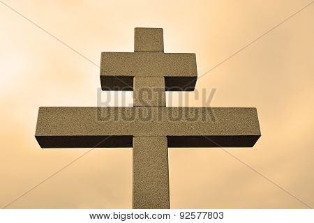 Big Cross Against The Sky In Sepia Tone