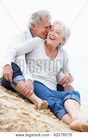 Senior Couple Sitting On Beach Together