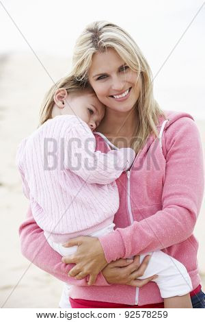 Mother Cuddling Young Daughter outdoors,outside,