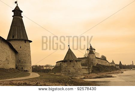 Stone Tower And Pskov Kremlin Fortress Wall At The Confluence Of Two Rivers. Sepia Toned
