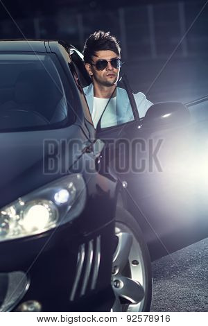 Handsome Young Man Sit In His Car. Gorgeous Guy With Eyeglasses. Outdoors - Outside
