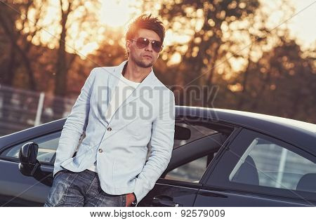 Trendy Handsome Young Man Leaning On His Car. Attractive Gorgeous Guy, Outdoors - Outside