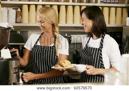 Two Women Working In Coffee Shop