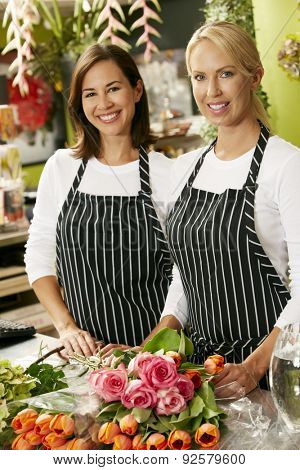 Portrait Of Two Sales Assistants In Florists Shop