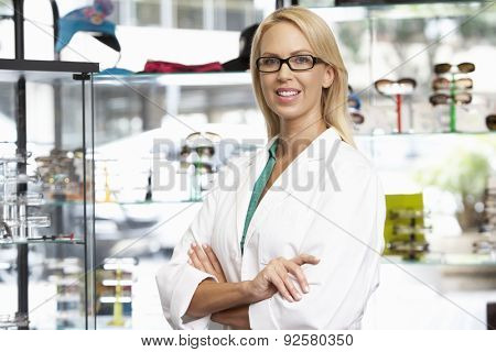 Portrait Of Female Optician By Glasses Display