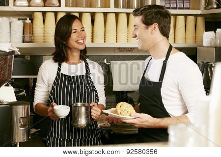 Man And Woman Working In Coffee Shop