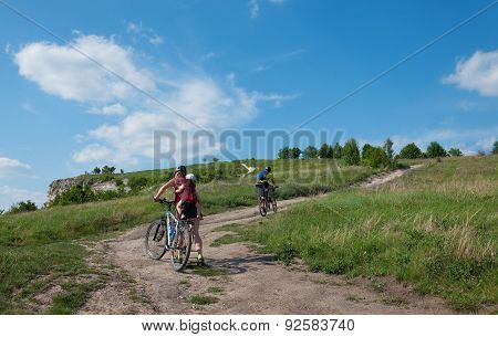 Family With Young Children  Mountain Bike Ride On Dirt Road.